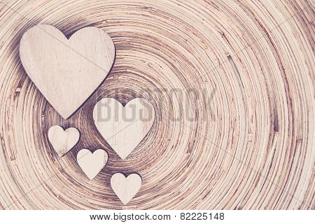 Valentine's Wooden Hearts On A Wooden Background In Retro Color