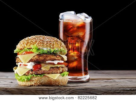 Hamburger and cola drink. Takeaway food.