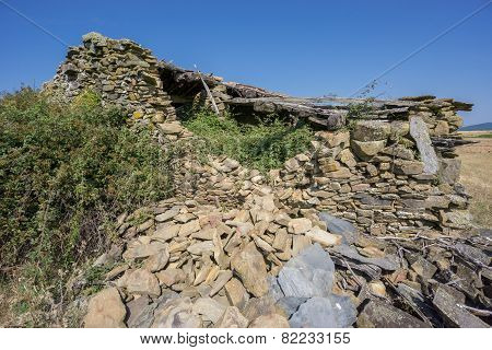 Abandoned old house made with stones, corner view