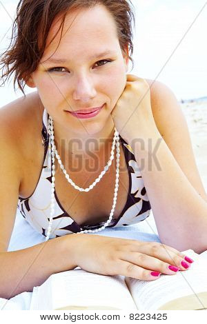 Young Woman On The Beach Reading Book
