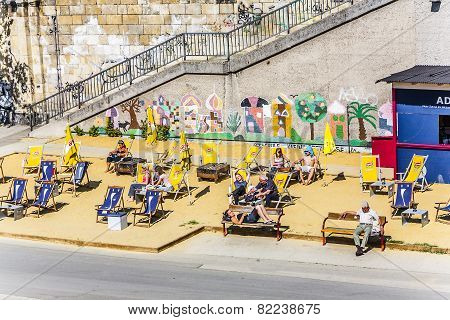 People Relax At The Beach Of The Danuvia Canal In Vienna