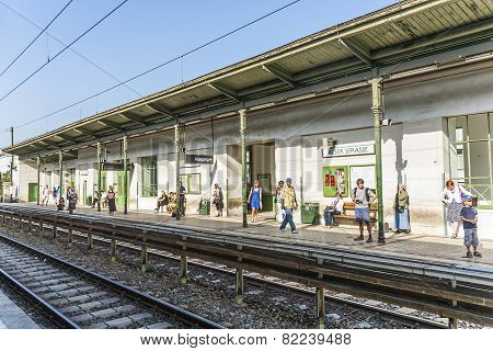 People Wait For The Next Train At Station Alser Strasse