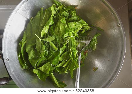 Stirring the vegetable - Japanese spinach or