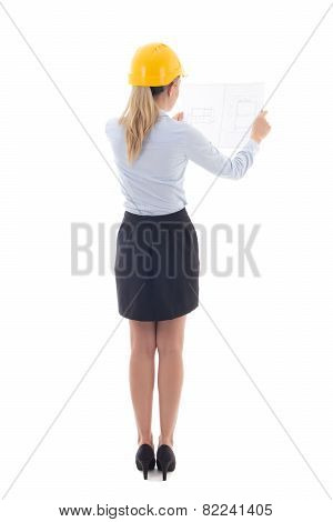 Back View Of Business Woman In Builder Helmet Holding Building Plan Isolated On White