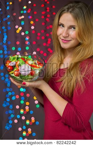 Smiling woman with fit salad on christmas background