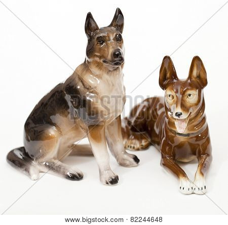 German Shepherds. Ceramic figurine, dog breed isolated on white