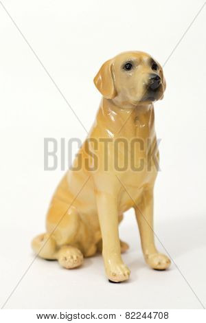 Goldador. Ceramic figurine, dog breed isolated on white