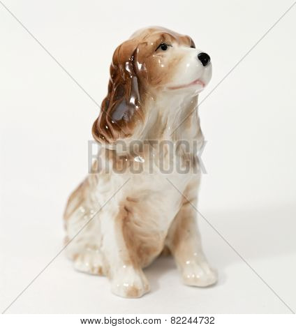 Cocker Spaniel. Ceramic figurine, dog breed isolated on white