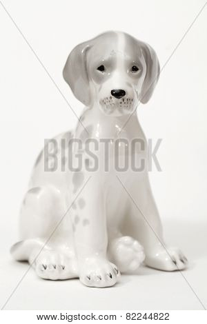 Spotted Dalmatians. Ceramic figurine, dog breed isolated on white