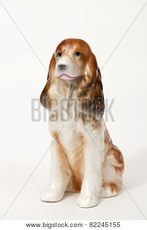 English Cocker Spaniel. Ceramic figurine, dog breed isolated on white