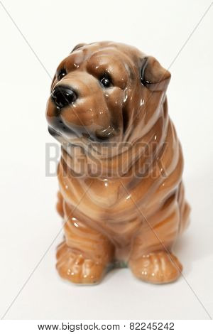 Shar pei puppy. Ceramic figurine, dog breed isolated on white