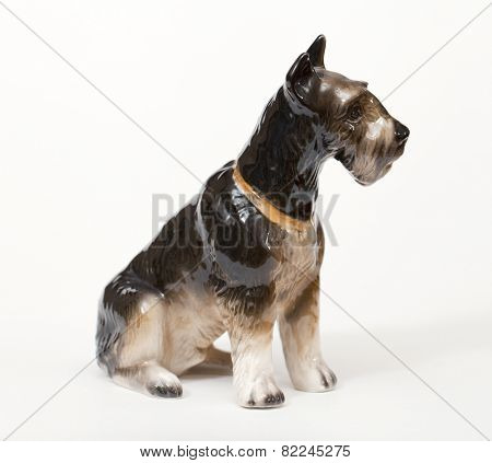 Riesenschnauzer. Ceramic figurine, dog breed isolated on white