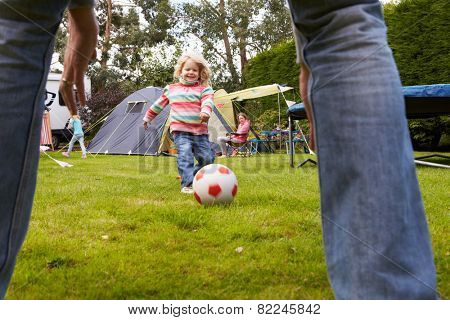Family Having Football Match On Camping Holiday