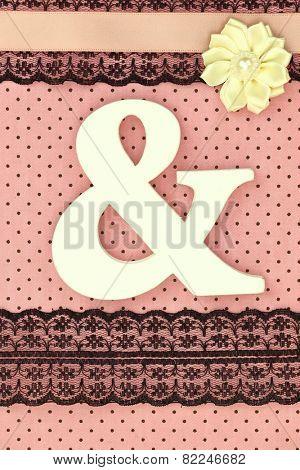 Wooden ampersand symbol on polka dots background