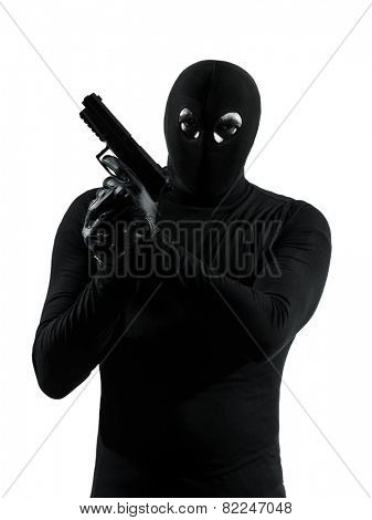 thief criminal terrorist holding gun portrait in silhouette studio isolated on white background
