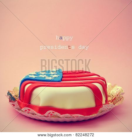the text Happy Presidents Day and a cake ornamented with the flag of the United States on a red background