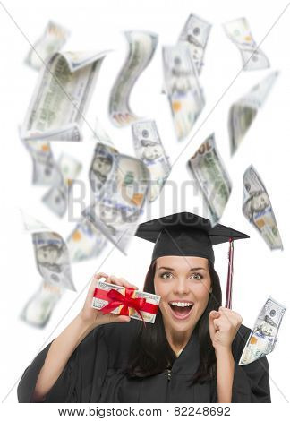 Excited Female Graduate in Cap and Gown Holding Stack of $100 Bills with Many Falling Around Her on White.