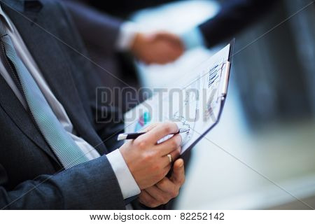 hands pointing at business document