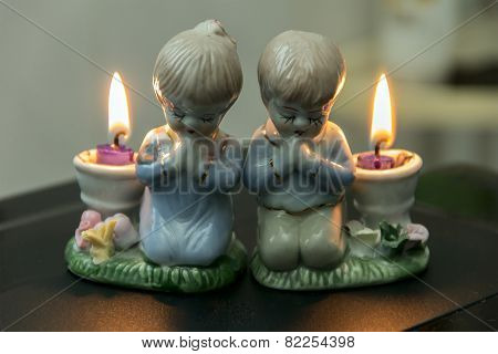 Two Lighted Candles