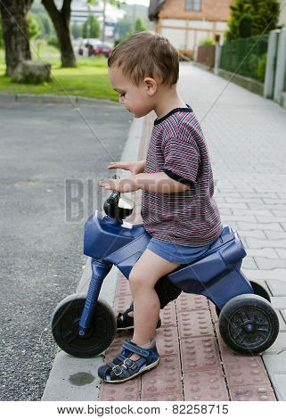 Child Riding Toy Bike