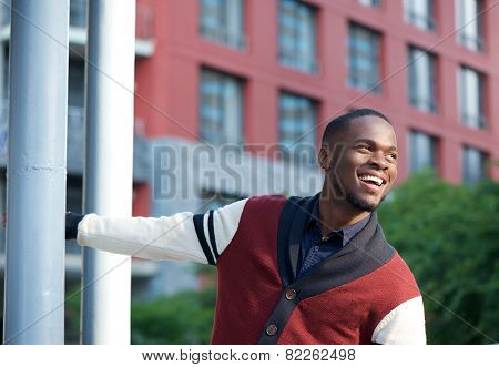 Confident Young Man Smiling Outdoors