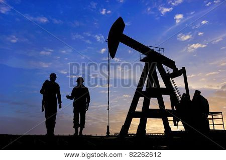 Workers produce oil.