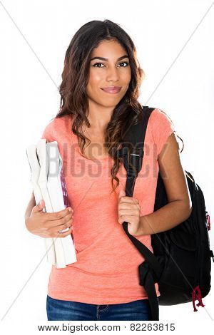 Happy young student holding her text books