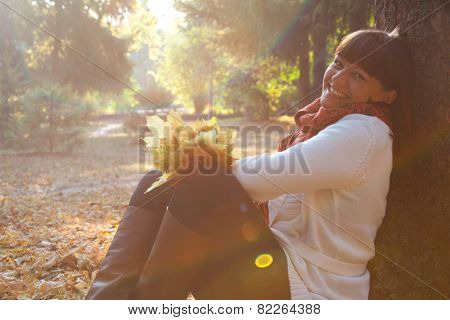 portrait of pretty woman in the autumn park