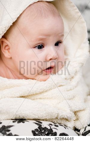 portrait of little baby and the white towel