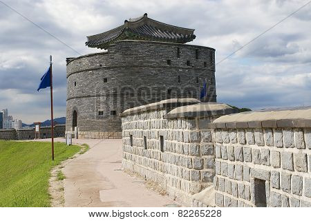Hwaseong fortress (Brilliant Fortress) exterior wall and tower in Suwon, South Korea.