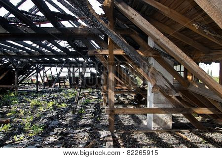 Ruin with burnt wood roof