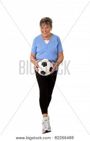 Senior Woman Walking With Football