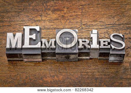 memories word in mixed vintage metal type printing blocks over grunge wood