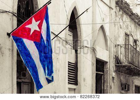 Cuban flag on a grunge decaying neighborhood