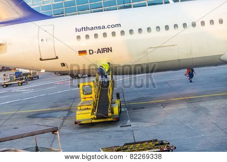 Worker Loads Cargo To Aircraft In Frankfurt