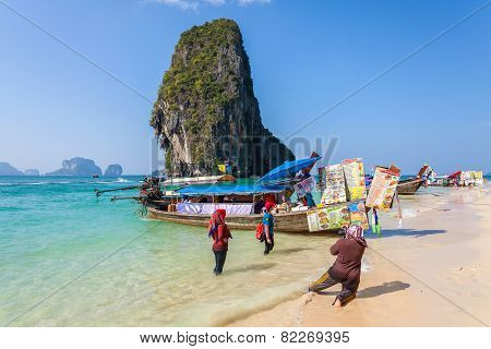 Boat Food Stalls and tourists On Railay Beach.