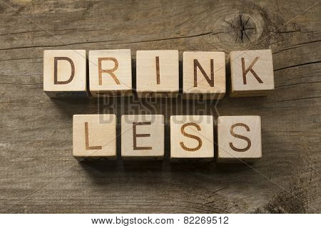 Text drink less on a wooden cubes on a wooden bacground