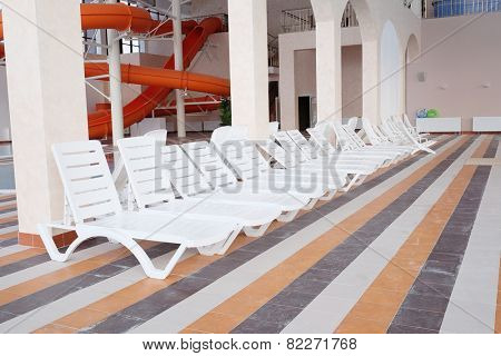 Many white empty chaise-longue