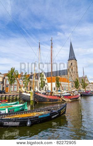 Pier With Old Boats In Harlingen