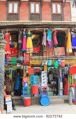 KATHMANDU, NEPAL - APRIL 2014 : Cookware, plastic utensils and clothes for sale in Kathmandu, Nepal on 12 April 2014.