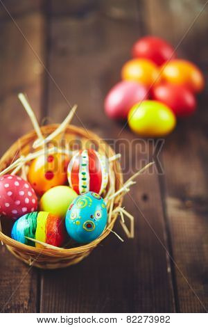 Easter painted eggs in small basket