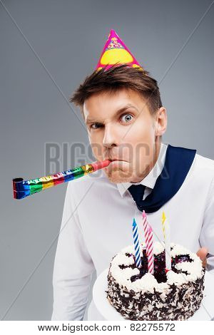 Young office manager holding cake
