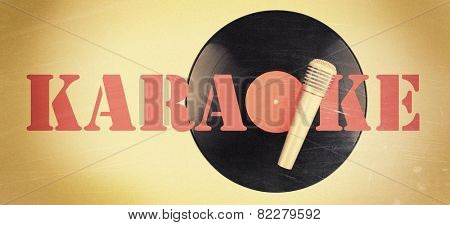 Black vinyl record and microphone on color background, Karaoke concept