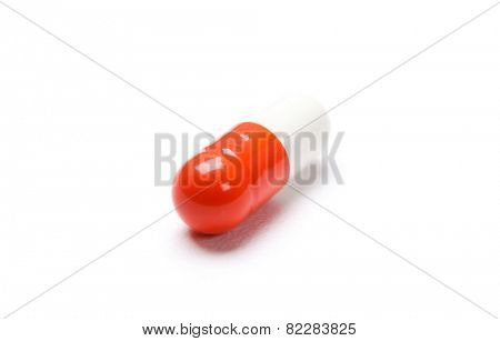 Vitamins red capsule, isolated on white. Healthcare concept.