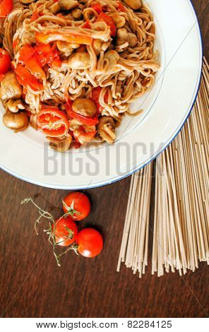 Japanese buckwheat soba noodles on brown wooden background