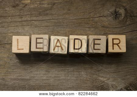 text Leader on a wooden background