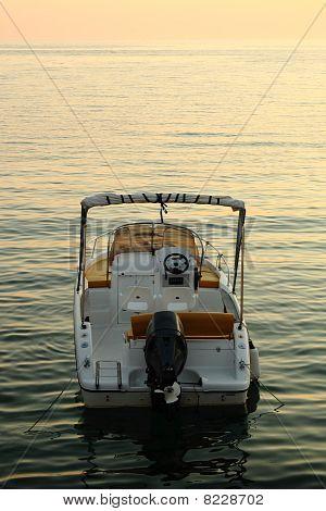Backside Of Motorized Boat With Sunset
