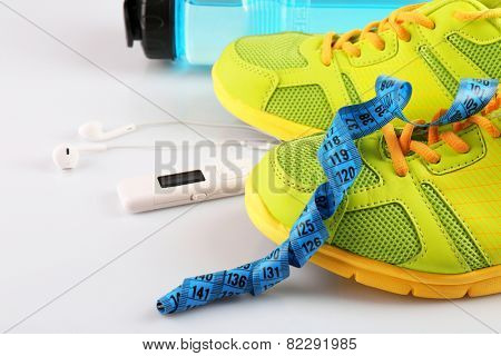 Sports shoes with measuring tape and player close up