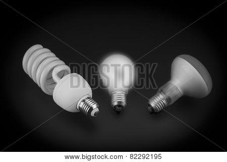 Three light bulbs on black