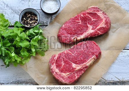 Raw beef steak on a wooden table